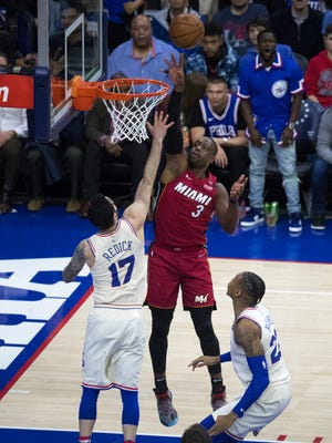 Miami's Dwyane Wade scores over JJ Redick in Game 2 Monday night at the Wells Fargo Center. Wade had a game-high 28 points.