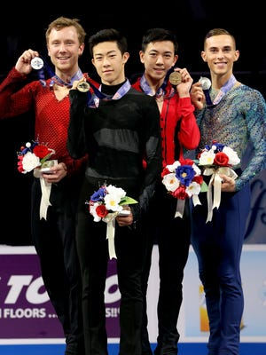Ross Miner, Nathan Chen, Vincent Zhou and Adam Rippon pose for photographers after the medal ceremony for the 2018 Prudential U.S. Figure Skating Championships at the SAP Center on Jan. 6, 2018.