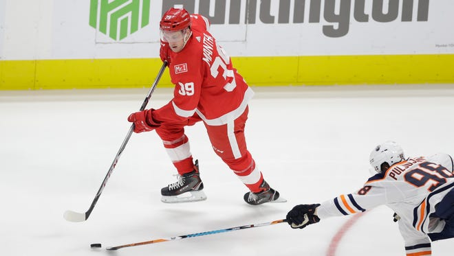 Anthony Mantha reaches for the puck during the third period against the Oilers on Wednesday night.