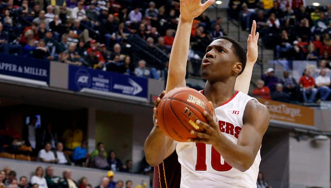 Wisconsin Badgers forward Nigel Hayes (10) takes a shot against the Minnesota Golden Gophers in the quarterfinals of the Big Ten tournament.