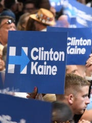Conventiongoers hold up signs supporting Hillary Clinton