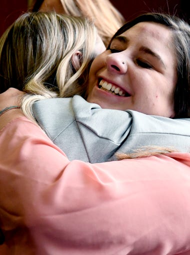 Former gymnast Alexis Alvarado, right, is hugged by Christine Harrison after the sentencing of Larry Nassar, Wednesday, Jan. 24, 2018. Both were patients of Nassar's and spoke in court. Victim impact statements wrapped up on Day 7 of the sentencing hearing in Lansing, followed by the verdict for the notorious doctor who   sexually assaulted girls and young women under the guise of medical treatment.