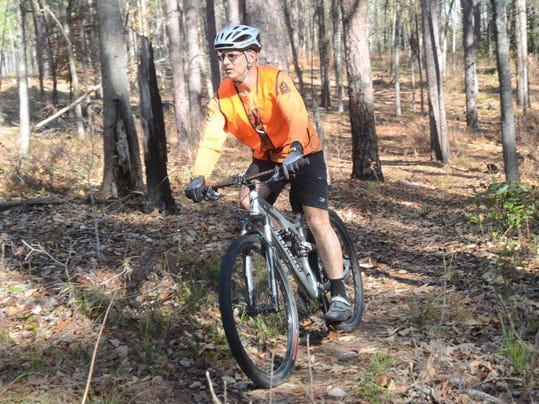 ANI Kisatchie Trail Maintenance Louis Guidry, a member of the Kisatchie Bicycle Club, is among the many local cyclists who use and voluntarily clean up the trails in the Kisatchie Forest. The Kisatchie Forestry Service held a meeting Tuesday, Dec. 9, 2014