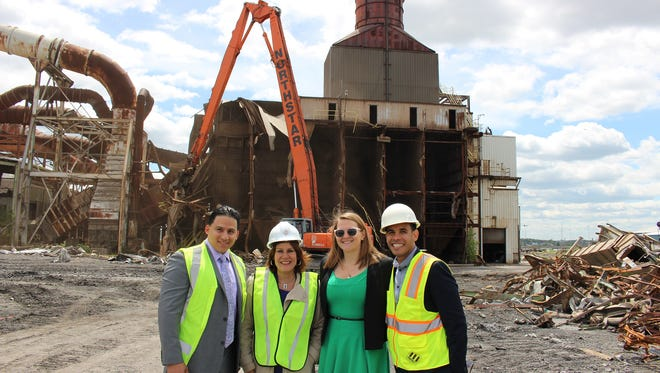 Northlight Capital Partnership conducted a demolition on May 8 of a structure at the former Gerdau site in Perth Amboy in order to make way for the redevelopment of the 92-acre property that will bring two warehouses, two waterfront parks and hundreds of jobs to the city. From left: Perth Amboy Redevelopment Commissioner Lionel Giron, Mayor Wilda Diaz, Redevelopment Agency Executive Director Annie Hindenlang and Commissioner Joel Rosa.