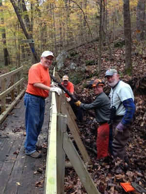 Volunteers Ron Beasley, Mike Rees, Gordon King and Ed Metcalf do trail maintenance on the Ozark Highlands Trail.