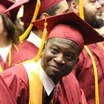 Rashawn Johnson looks into the crowd at Pearl River Community College's annual commencement exercise Friday in Poplarville.