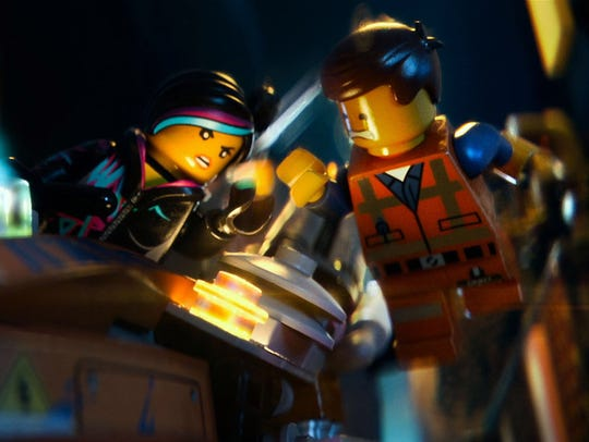Wyldstyle (voiced by Elizabeth Banks) and Emmet (Chris