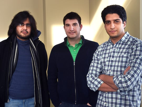 From left, University of Nevada students Vahid Behzadan, Ph.D student in cybersecurity, Pedram Rogbanchi, Ph.D student in mining engineering and Mehdi Rahimi, Ph.D student in biomedical engineering. pose for a portrait on campus in Reno on Jan. 31, 2017.  All three students are from Iran.