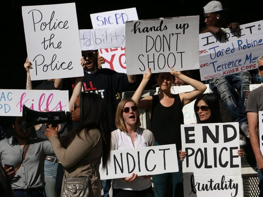 Activists take to the streets of Sacramento to protest the death of Stephon Clark on March 29, 2018.