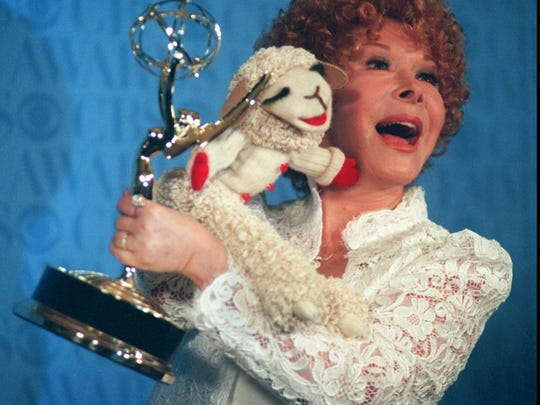 Shari Lewis poses with Lamb Chop at the 1996 Emmy Awards.