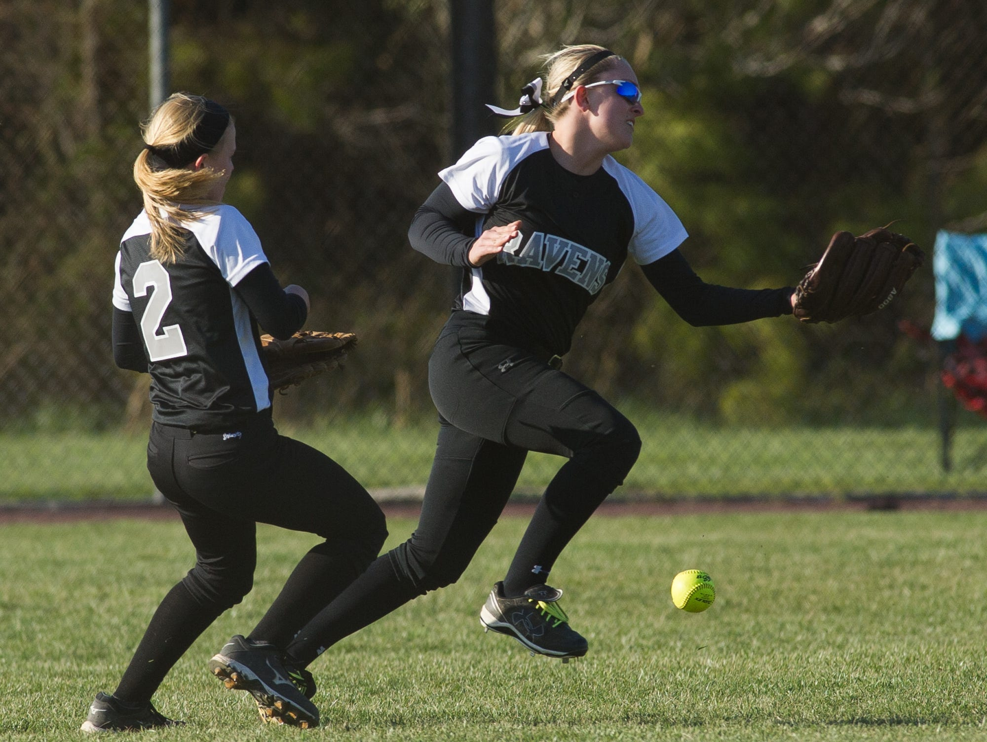 Sussex Tech's Nicole Hovatter (2), left and teammate Brooke Ward (4) miss a fly ball in their out field in their game against Sussex Central.
