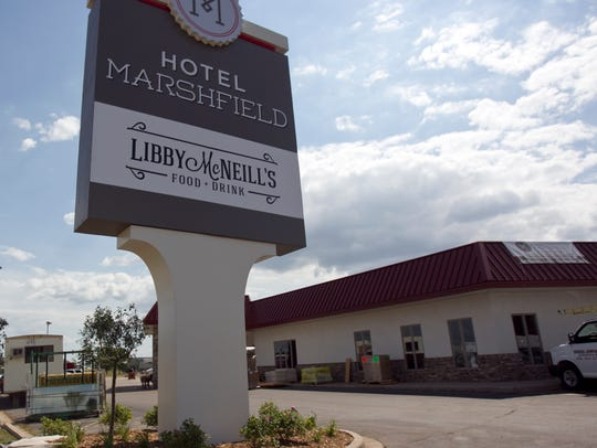 The Hotel Marshfield sign is on display along South
