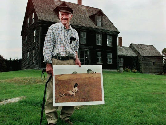 "-  Dudley Rockwell, 87, Andrew Wyeth's brother-in-law, poses with a copy of the famous painting ""Christina's World"" outside the Olson House in Cushing, Maine, Aug. 23, 2000."