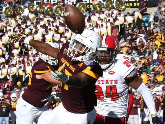 Arizona State wide receiver Ryan Newsome, 17, can't