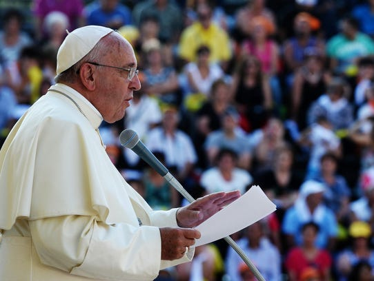 Pope Francis delivers his speech in front of  Isernia's cathedral, southern Italy, Saturday, July 5, 2014. Francis on Saturday traveled to Molise, an agricultural region in the heart of southern Italy, where unemployment is chronically high. (AP Photo/Salvatore Laporta)