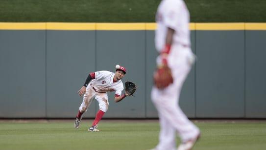 Reds center fielder Billy Hamilton catches a line drive