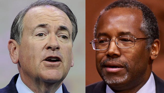 Mike Huckabee, left, and Dr. Ben Carson