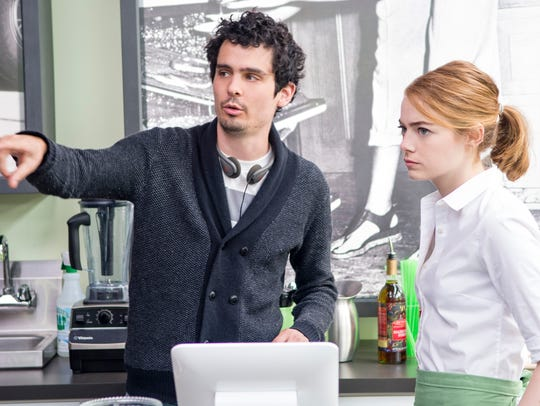Director Damien Chazelle and Emma Stone on the set