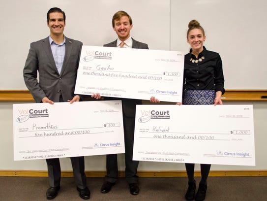 Alex Adams, center, shows off the $1,500 check he won