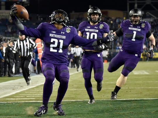 Northwestern safety Kyle Queiro (21) celebrates his interception and touchdown during the second half of the Music City Bowl at Nissan Stadium in Nashville, Tenn., Friday, Dec. 29, 2017.