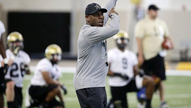 Vanderbilt head football coach Derek Mason directs players during an NCAA college football practice Thursday, Aug. 6, 2015, in Nashville, Tenn. (AP Photo/Mark Humphrey)