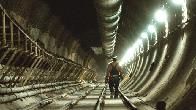Yucca Mountain construction worker passes through the main tunnel at the Yucca Mountain Project in Yucca Mountain in 1998.