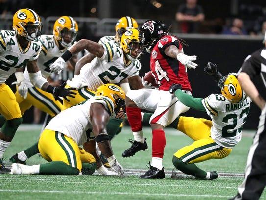 Falcons running back Devonta Freeman twists and turns