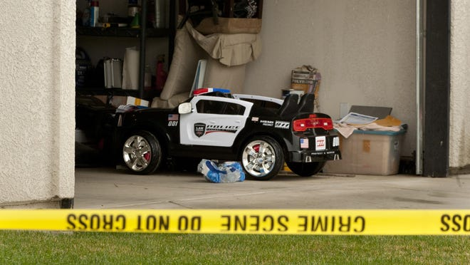 A toy police car sat in the garage as Tulare County Sheriff Department investigated the homicide of Exeter police officer Daniel Green in 2015.