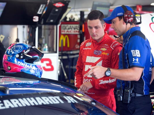 Alex Bowman, left talks with the crew of Dale Earnhardt Jr. before practice Friday July 15, 2016 at New Hampshire Motor Speedway in Loudon, N.H. Bowman will take Earnhardt's place for Sunday's New Hampshire 301 auto race after it was announced that Earnhardt will miss the race due to concussion-like symptoms.(AP Photo/Jim Cole)