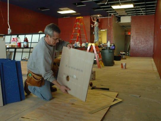 In February 2004, Jerry Vicari cuts ceiling panels