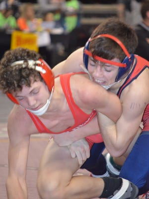 Teurlings Catholic's Colten Sonnier, top, reaches the finals at 113 pounds at the Division II State Wrestling Tournament on Saturday in Bossier City.