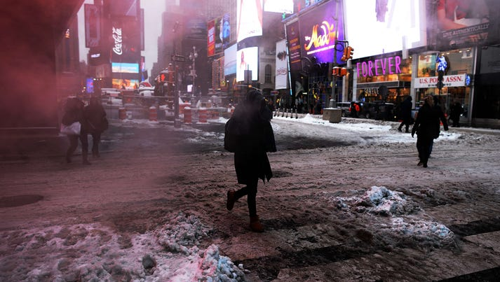 People make their way in New York's Times Square after