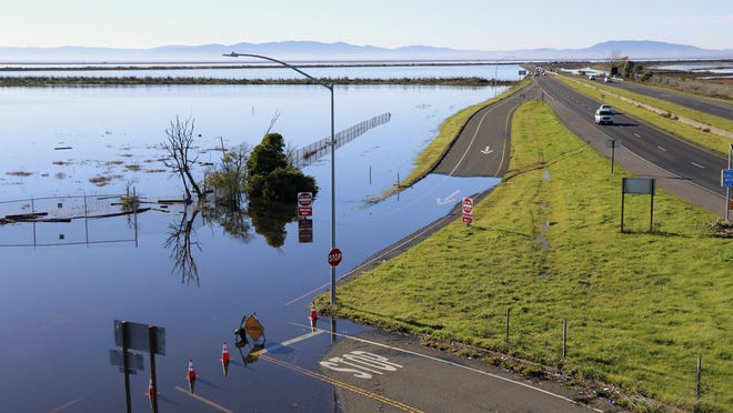 This Jan. 14 photo shows flooding along Highway 37 near Vallejo, Calif. Ocean rise already is worsening the floods and high tides sweeping California this winter, climate experts say.