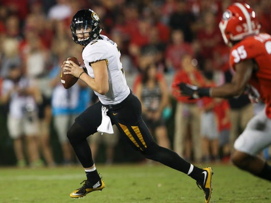 Missouri quarterback Drew Lock (3) looks for an open receiver during the second half of an NCAA college football game against Georgia on Saturday, Oct. 14, 2017, in Athens, Ga. Georgia won 53-28. (AP Photo/John Bazemore)