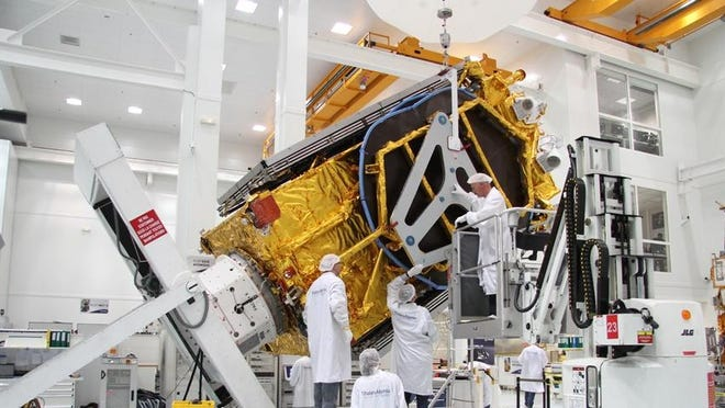 Turkmenistan's first communication's satellite, shown during processing by Thales Alenia Space, is nearing launch from Cape Canaveral on a SpaceX Falcon 9 rocket.