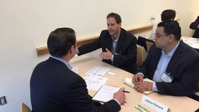 OceanTailer co-founders Bar Lev, left, and Ralph Castro, right, meet with venture capitalist James Hill of Edison Partners Associates during the New Jersey Founders and Funders event at the New Jersey Economic Development Authority's Commercialization Center for Innovative Technologies in North Brunswick.