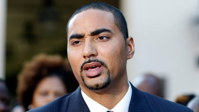 Justin T. Bamberg, a lawyer for the family of Walter Scott, answers questions during a Sept. 10, 2015, news conference.