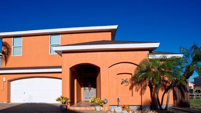 """15354 Bowsprit; an orange stucco beauty on a prime """"shady side""""  Padre Island canal"""