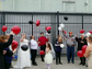 The couple releases balloons outside of the Walmart