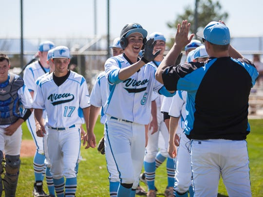 Canyon View's Tyler Hardin celebrates with his teammates after hitting a home run during the first game against Carbon, Tuesday, April 5, 2016.