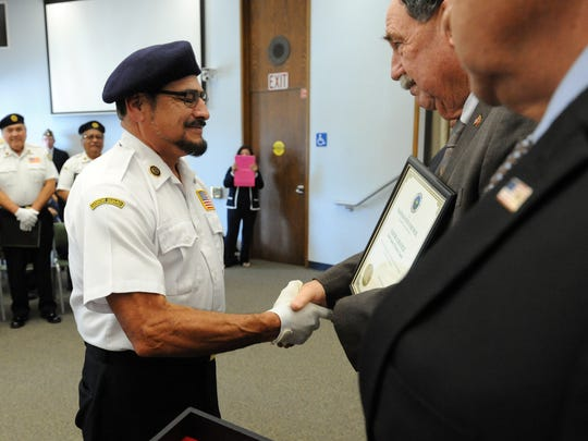 District 28 Honor Guard member Louie Chavez shakes Mayor Joe Gunter's hand on Thursday at the ceremony.