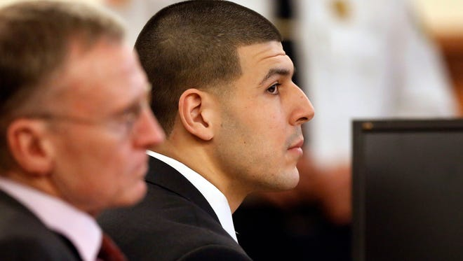 Former New England Patriots football player Aaron Hernandez, right, listens during his murder trial as defense attorney Charles Rankin, left, looks on, Thursday, Jan. 29, 2015, in Fall River, Mass.