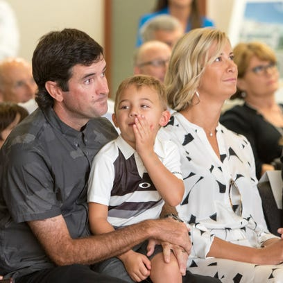 Professional golfer Bubba Watson and his family watch