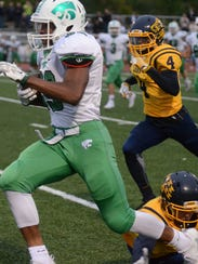 Novi's Nathan Hankerson, left, dashes past a couple