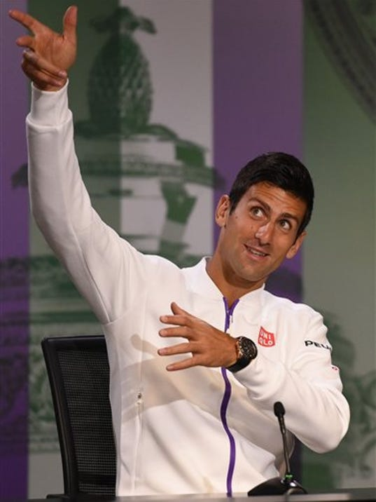 Current Wimbledon men's singles champion Serbia's Novak Djokovic gestures during  a press conference at the Wimbledon Championships at the All England Lawn Tennis and Croquet Club, in  Wimbledon London Sunday June 28, 2015.