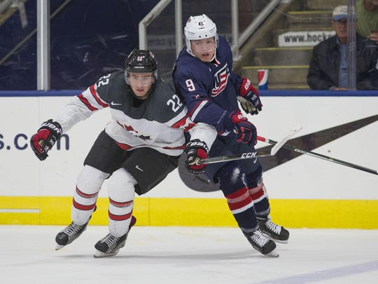 Battling for room on the ice Saturday are Team Canada's Michael McCloud (left) and Team USA's Kieffer Bellows.