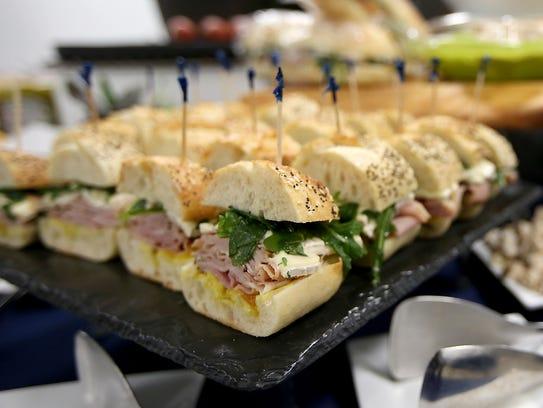 Deli sandwiches fill a tray at the Centerplate facility