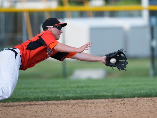 Palmyra's Brandon Charochak makes a diving attempt at a line drive but is unable to hold on for the out as Palmyra defeated West York 7-3 in the first round of the PIAA District III AAA tournament on Tuesday.