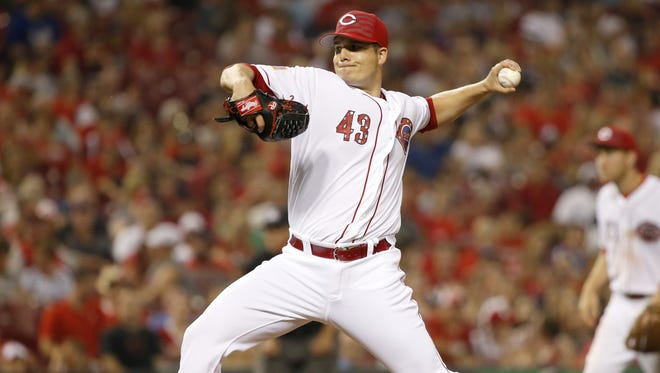 Cincinnati Reds relief pitcher Manny Parra (43) delivers a pitch in the seventh inning during the Major League Baseball game between the Cincinnati Reds and the Milwaukee Brewers, Saturday, July 4, 2015, at Great American Ball Park in Cincinnati.