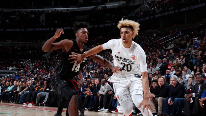 "Mar 29, 2017; Chicago, IL, USA; McDonalds All-American West forward Brian ""Tugs"" Bowen II (20) drives to the basket against East forward Lonnie Walker IV (14) during the 40th Annual McDonald's High School All-American Game at the United Center."